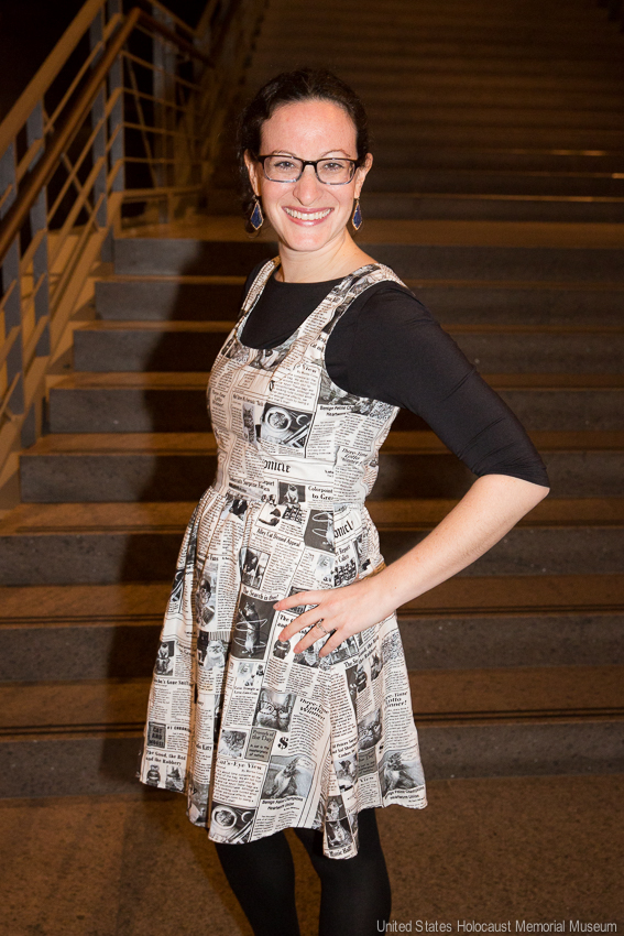 Elissa Frankle wearing a dress made of newspaper articles.